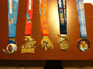 My medals from 2012.  (Right to Left)- Disney World 1/2 Marathon, Disney World Marathon, Goofy Challenge, Disneyland 1/2 Marathon, Coast to Coast Challenge