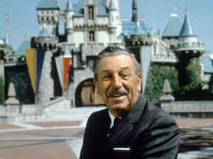 Walt Disney in front of Sleeping Beauty's Castle