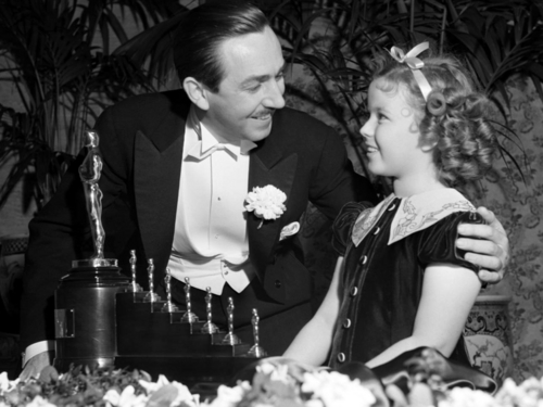 Walt-Disney-Getting-Oscar-for-Snow-White-and-the-Seven-Dwarfs-walter-e-disney-6659154-500-375.jpg